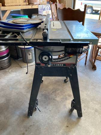 Photo Craftsman table saw- Cast iron top - $200 (Fort Collins)