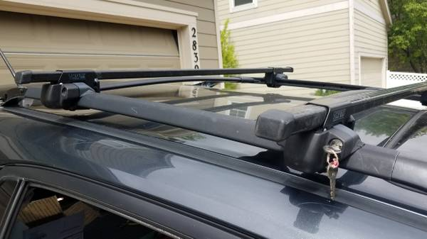 Photo Thule Roof Rack for factory rack raised siderails - Locks and Key - $100 (Fort Collins)