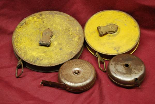 Photo Old Hand Crank Tape Measures and Vintage Voltage Testers (Moorland)