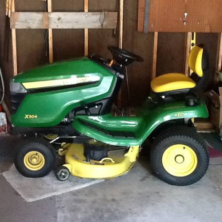 Photo John Deere x304 tractor with mower - $1,950 (Ruthven, IA)