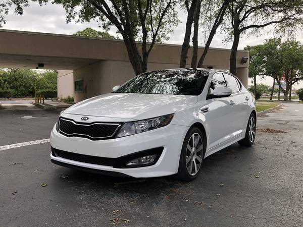 Photo 2012 Kia Optima SX only 22k miles on brand new engine - $6950 (Fort Myers)