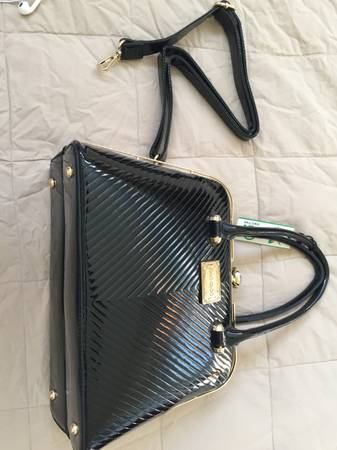 Photo DESIGNER BAG. ...(((J CHOO))).NEVER USED....can drop off locally - $125 (PUNTA GORDA)