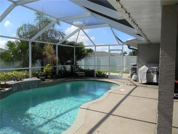 Photo Extra large pool area has two separate gathering areas. (Cape Coral, FL)
