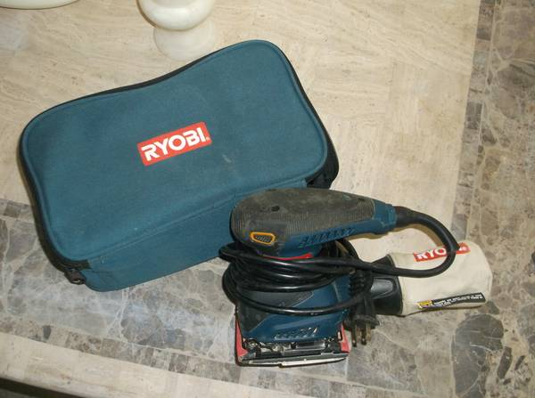 Photo Ryobi Orbital Sander, Vacuum Bag Attachment and Case - $20 (Windmill Village)
