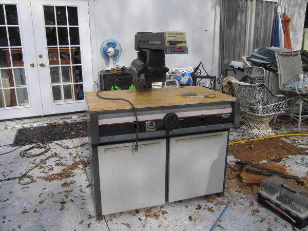 Photo SEARS CRAFTSMAN RADIAL ARM SAW WITH CABINET - $100 (PORT CHARLOTTE)