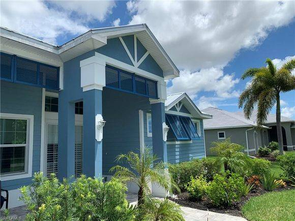 Photo This home features a SW Florida Coastal feel with Metal roof. (Cape Coral)
