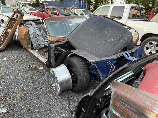 Photo 1964 cadillac body shell stripped out on rolling chassis in bare metal - $1,250 (Poolesville)