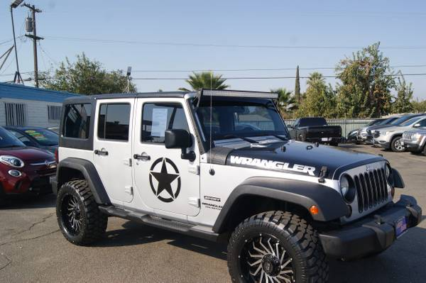 Photo 2012 Jeep Wrangler Unlimited 4WD 4dr Sport Custom - $26,995 (Fresno)