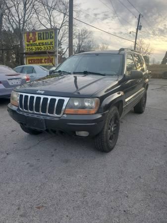 Photo 2002 Jeep Grand Cherokee Trade In - $1 (EZRIDE.COM)