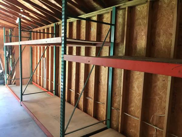 Photo Used Heavy Duty warehouse shelving-3 Sections-8Hx42Wx8L. Partical board - $399 (Alachua)