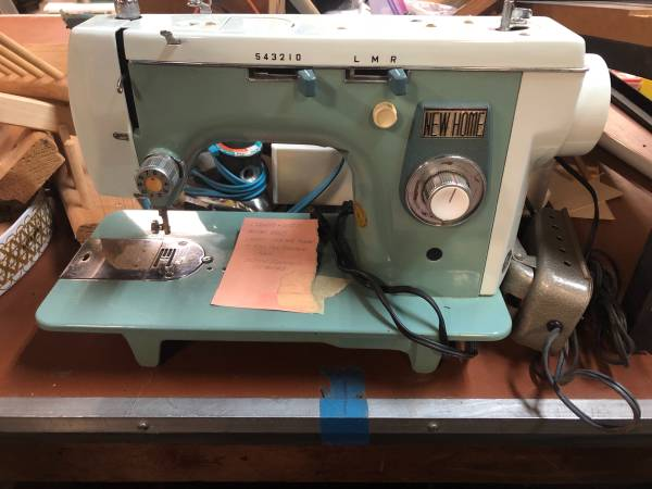 Photo Vintage blue New Home Sewing Machine - $45 (Gainesville)