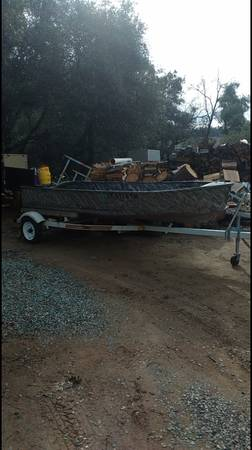 Photo 14 ft aluminum boat and trailer - $300 (Plymouth)