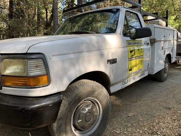 Photo 96 Ford F 350 XL with fully enclosed utility bed, heavy duty rack - $3,900 (Grass Valley)