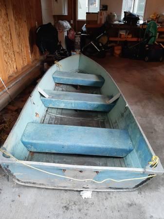 Photo 12 Ft Aluminum fishing boat  New Trolling Motor, Battery Etc. - $315 (Grand Rapids)