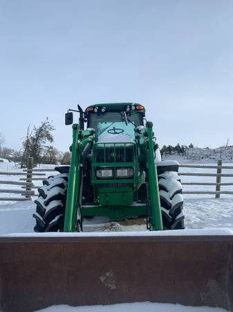 Photo John Deere 7520 Tractor with Bucket and Grapple - $62,000 (BIG TIMBER)