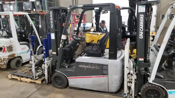 Photo 2015 Nissan Forklift Three Stage Electric 4 Wheel Sit Down (Green Bay)