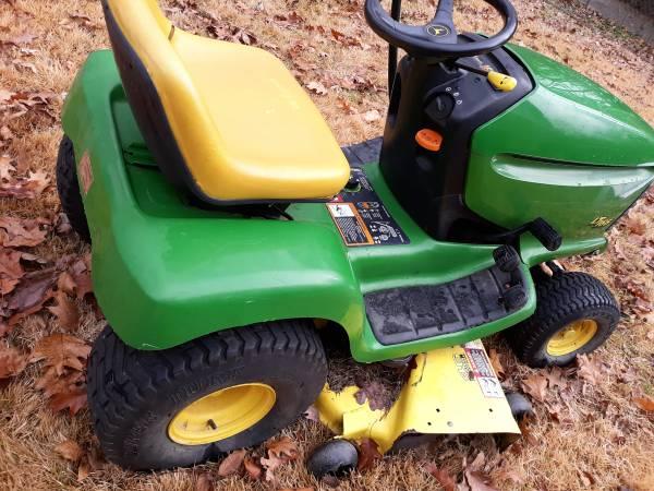 Photo John Deere and Craftsman riding lawnmower - $350 (High Point, NC)