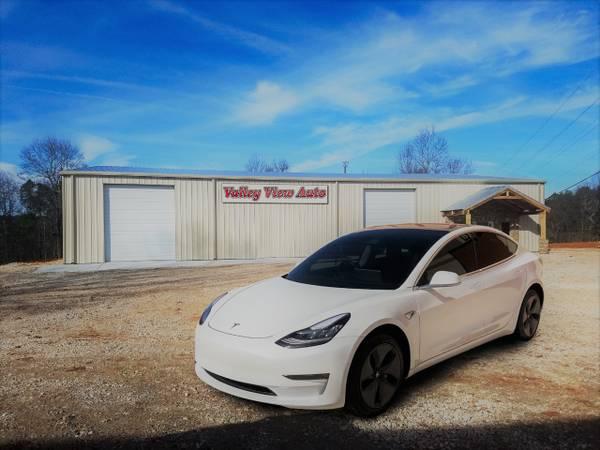 Photo 2018 Tesla Model 3 Long Range - $33,750 (10300 106Th St Ne Bismarck, ND 58503)