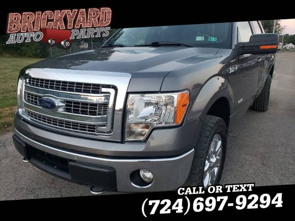 Photo 2014 Ford F-150 4WD SuperCrew 5-12 Ft Box XLT - $10,900 (Ford F-150 Truck)