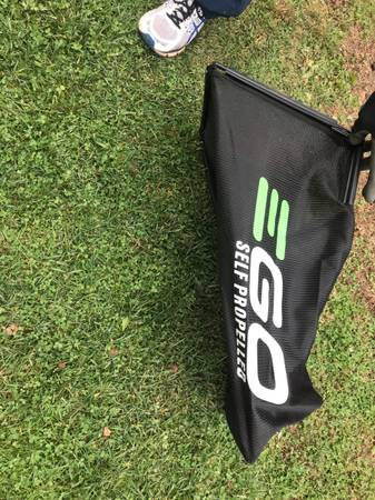 Photo EGO lawn mower grass catcher bag  battery charger - $40