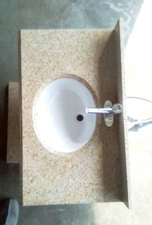 Photo Granite counter top with undermount sink, Moen faucet universal splash - $75 (North Helena)
