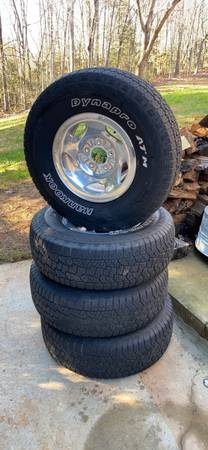 Photo 1999 FORD F150 OEM Wheels and tires - $450 (Hickory)