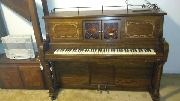 Photo Self player piano with rolls. - $300 (Springs Road)