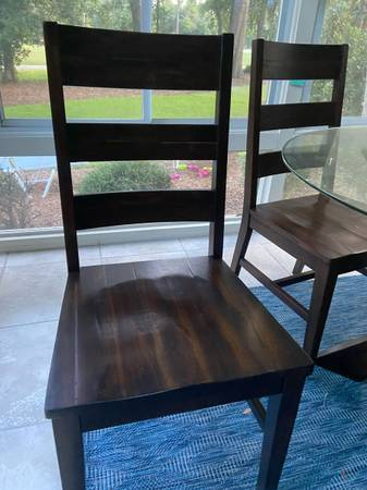 Photo Pier 1 glass table and 5 chairs - $450