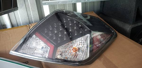 Photo Nissan altima 07-09 head lights and tail lights. - $120 (holland)