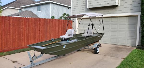 Photo Custom Alumacraft 15ft jon boat with trailer and motor - $3,200 (The woodlands)