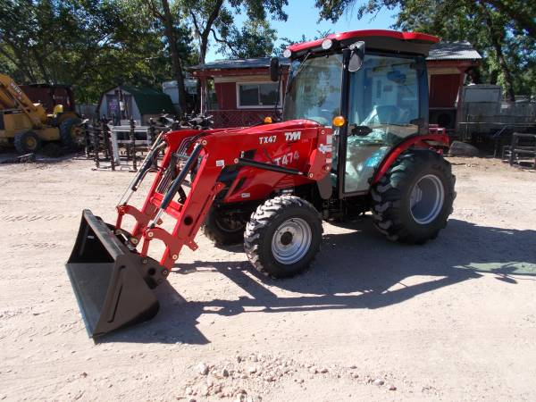 Photo New TYM T474 CAB diesel 4x4 tractor w front end loader (Magnolia)