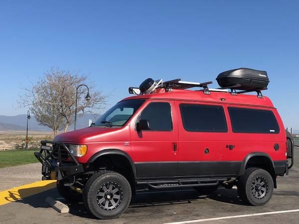 Photo Ford E350 4x4 Conversion Van - $60,000