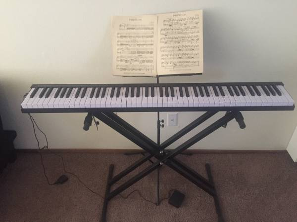 Photo Like new Costway 88 keys portable piano set (stand  sheet holder) - $150 (Mckinleyville)