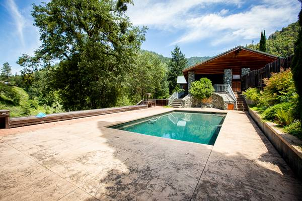 Photo REDUCED Stunning custom home on 4.5 ac of river front property (Willow Creek)