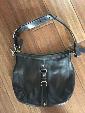 Photo Black Coach Handbag - $40