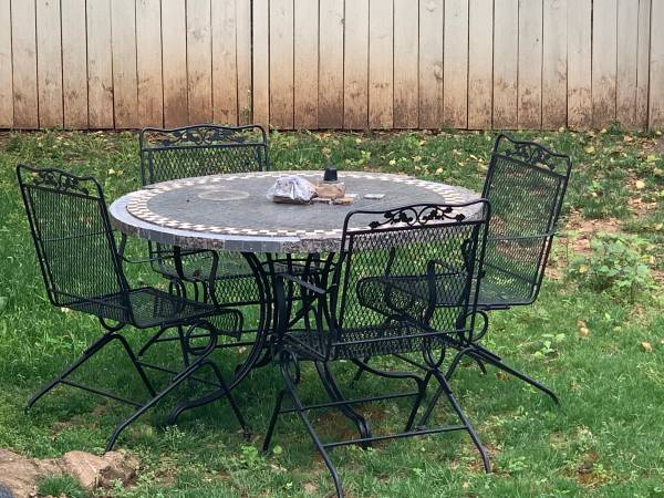 Photo tiled patio table with iron chairs - $200 (Decatur)