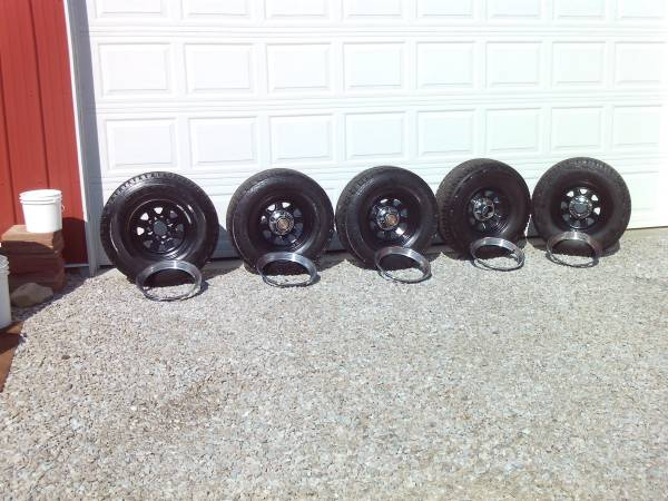 5 31x10.50-15s on 5 ford wagon wheels very good tread - $450 (indy south side)