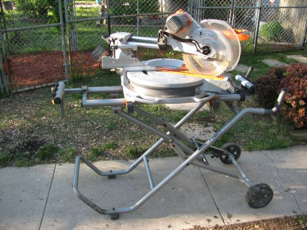 Photo Ridgid 123939 sliding compound saw and stand used on 1 small job - $400 (Indy)
