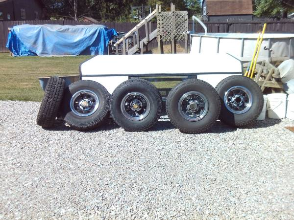 Photo ford wagon wheels with centers and rings 31x10.50-15 very good tread - $450 (indy south side)