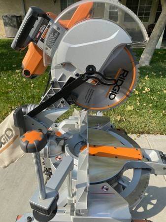 Photo 12quot Compound Miter Saw - Ridgid w stand - Never used - $450 (Victorville)