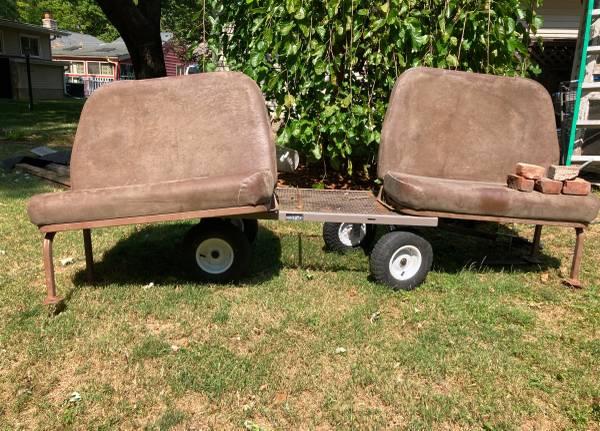 Photo Bus seats over wheel well. - $20 (Iowa City)