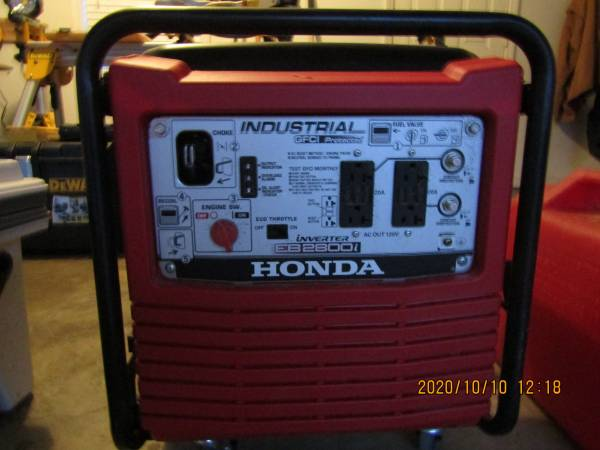 Photo Brand new never used Honda EB2800i Generator and 3 full gas cans - $800 (Madison Ms.)