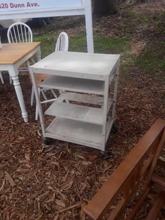Photo Metal stand with adjustable shelves on wheels - $40 (1620 Dunn Ave., The Truck Taxi Lot)