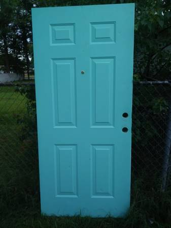 Photo exterior metal door with peep hole and hinges 36 x 79 12 - $50 (Beach and University blvd area)