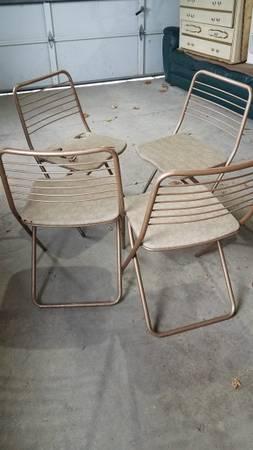 Photo Metal folding chairs vinyl set of 4 - $10 (westside or southside Janesville)