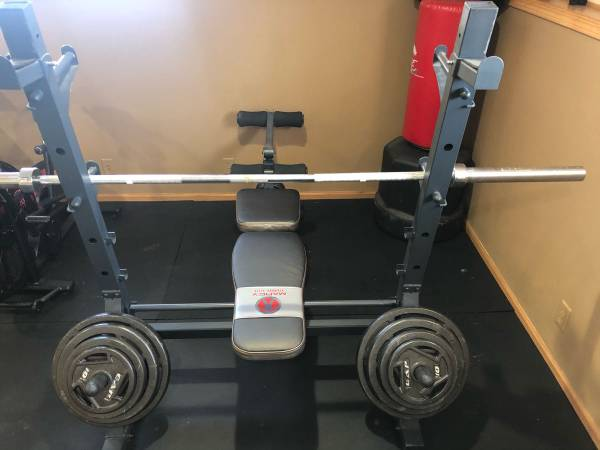 Photo Olympic Weight bench set with bench and barbell - $500 (Janesville)