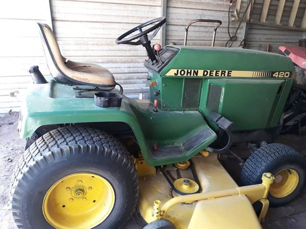 Photo not for sale ISO. john Deere 420 for parts mostly. With deck (WYNNE,AR)
