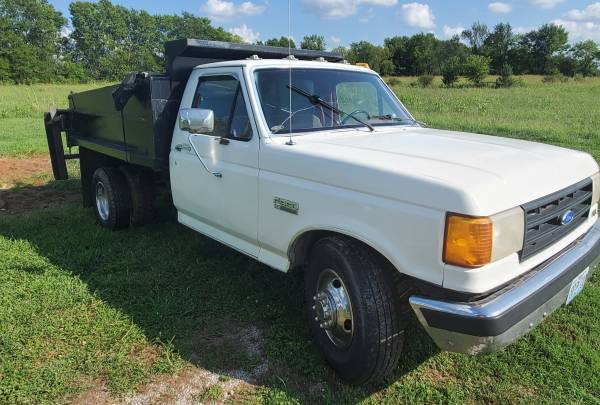 Photo 1988 Ford F350 1 Ton dump truck with spreader box and roller - $7,500 (carthage)