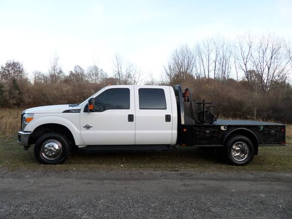 Photo 2015 FORD F350 POWERSTROKE DUALLY FLATBED CREW CAB 4X4 SOUTHERN TRUCK - $25900 (PETERSBURG MI)