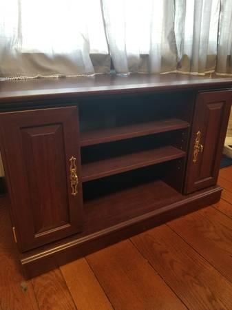 Photo Corner TV stand - $25 (Blackman Twp.)